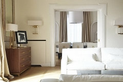 Living room con comò in noce e ottone e divano in tessuto